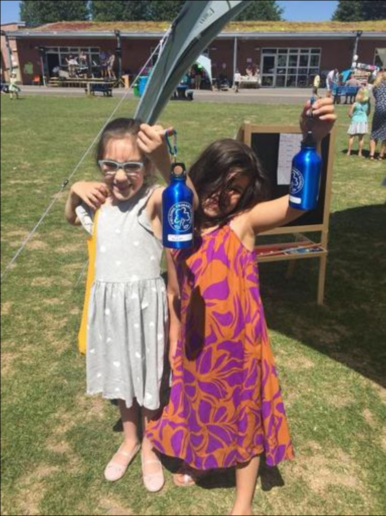 Fielding Primary Summer Fair going green - showing off refillable water bottles
