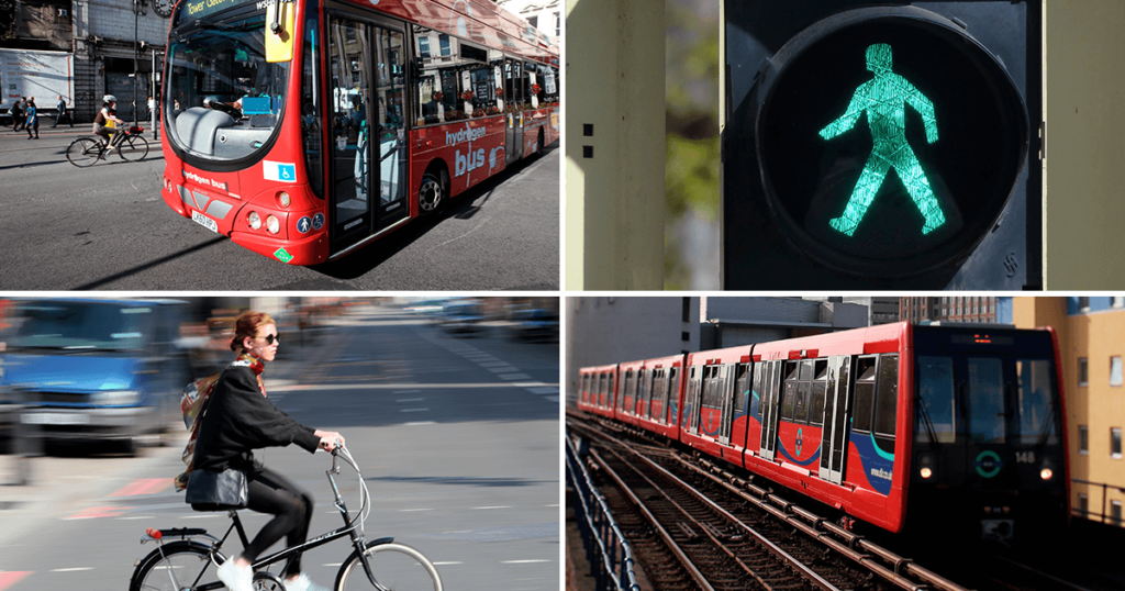 transport showing bus, person on bicycle, metro train, green man traffic light
